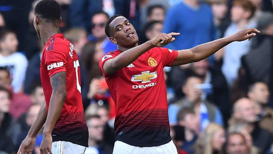 Manchester United's French striker Anthony Martial (R) celebrates with Manchester United's English striker Marcus Rashford (L) after scoring their second goal during the English Premier League football match between Chelsea and Manchester United at Stamford Bridge in London on October 20, 2018. (Photo by Glyn KIRK / AFP) / RESTRICTED TO EDITORIAL USE. No use with unauthorized audio, video, data, fixture lists, club/league logos or 'live' services. Online in-match use limited to 120 images. An additional 40 images may be used in extra time. No video emulation. Social media in-match use limited to 120 images. An additional 40 images may be used in extra time. No use in betting publications, games or single club/league/player publications. /         (Photo credit should read GLYN KIRK/AFP/Getty Images)