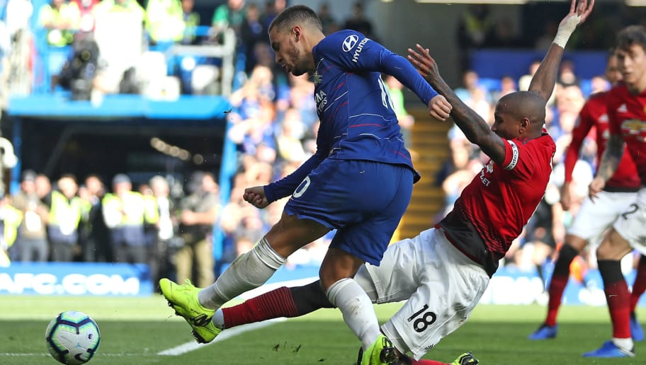 Chelsea's Belgian midfielder Eden Hazard (L) is injured as Manchester United's English midfielder Ashley Young slides in to prevent his shot during the English Premier League football match between Chelsea and Manchester United at Stamford Bridge in London on October 20, 2018. (Photo by Daniel LEAL-OLIVAS / AFP) / RESTRICTED TO EDITORIAL USE. No use with unauthorized audio, video, data, fixture lists, club/league logos or 'live' services. Online in-match use limited to 120 images. An additional 40 images may be used in extra time. No video emulation. Social media in-match use limited to 120 images. An additional 40 images may be used in extra time. No use in betting publications, games or single club/league/player publications. /         (Photo credit should read DANIEL LEAL-OLIVAS/AFP/Getty Images)