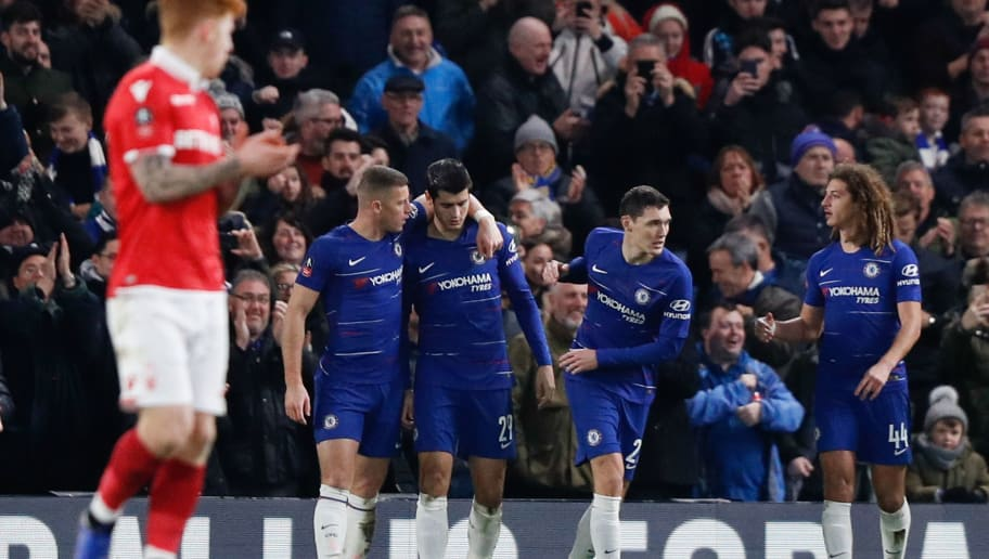 Chelsea's Spanish striker Alvaro Morata (C) celebrates scoring the opening goal with Chelsea's English midfielder Ross Barkley (2L), Chelsea's Danish defender Andreas Christensen (2R) and Chelsea's English-born Welsh midfielder Ethan Ampadu (R) during the English FA Cup third round football match between Chelsea and Nottingham Forest at Stamford Bridge in London on January 5, 2019. (Photo by Adrian DENNIS / AFP) / RESTRICTED TO EDITORIAL USE. No use with unauthorized audio, video, data, fixture lists, club/league logos or 'live' services. Online in-match use limited to 120 images. An additional 40 images may be used in extra time. No video emulation. Social media in-match use limited to 120 images. An additional 40 images may be used in extra time. No use in betting publications, games or single club/league/player publications. /         (Photo credit should read ADRIAN DENNIS/AFP/Getty Images)