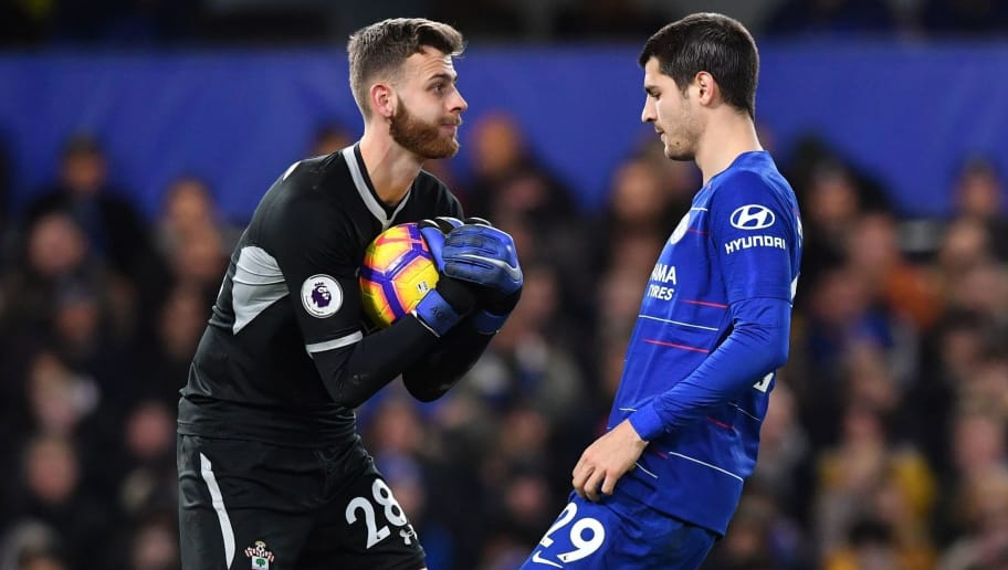 Southampton's English goalkeeper Angus Gunn catches the ball under pressure from Chelsea's Spanish striker Alvaro Morata (R) during the English Premier League football match between Chelsea and Southampton at Stamford Bridge in London on January 2, 2019. (Photo by Ben STANSALL / AFP) / RESTRICTED TO EDITORIAL USE. No use with unauthorized audio, video, data, fixture lists, club/league logos or 'live' services. Online in-match use limited to 120 images. An additional 40 images may be used in extra time. No video emulation. Social media in-match use limited to 120 images. An additional 40 images may be used in extra time. No use in betting publications, games or single club/league/player publications. /         (Photo credit should read BEN STANSALL/AFP/Getty Images)