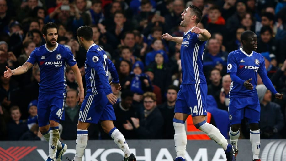 Chelsea's English defender Gary Cahill (2nd R) celebrates with teammates after scoring the opening goal of the English Premier League football match between Chelsea and Stoke City at Stamford Bridge in London on December 31, 2016. / AFP / Adrian DENNIS / RESTRICTED TO EDITORIAL USE. No use with unauthorized audio, video, data, fixture lists, club/league logos or 'live' services. Online in-match use limited to 75 images, no video emulation. No use in betting, games or single club/league/player publications.  /         (Photo credit should read ADRIAN DENNIS/AFP/Getty Images)