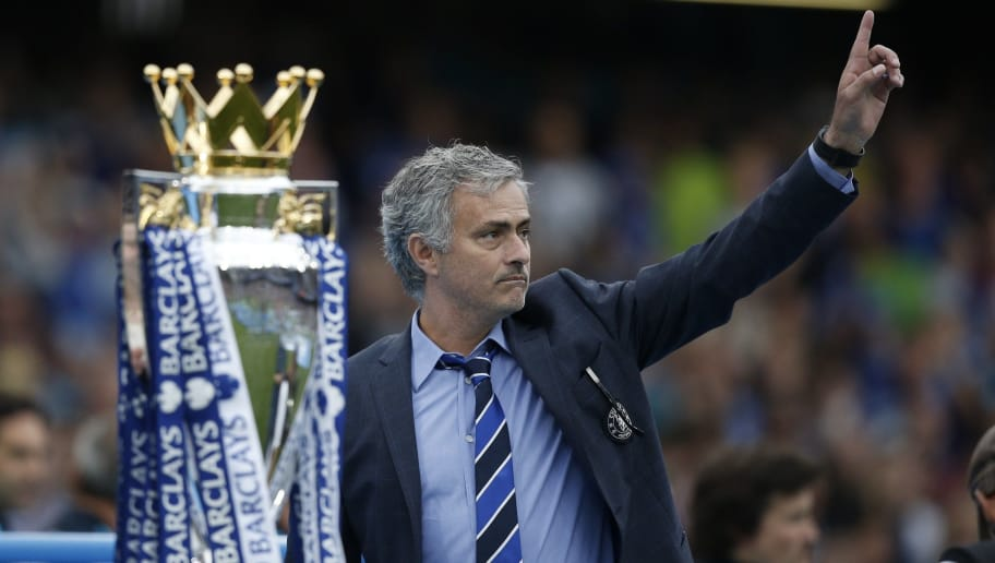 Chelsea's Portuguese manager Jose Mourinho (R) gestures during the presentation of the Premier League trophy after the English Premier League football match between Chelsea and Sunderland at Stamford Bridge in London on May 24, 2015. Chelsea were officially crowned the 2014-2015 Premier League champions.  AFP PHOTO / ADRIAN DENNIS  RESTRICTED TO EDITORIAL USE. NO USE WITH UNAUTHORIZED AUDIO, VIDEO, DATA, FIXTURE LISTS, CLUB/LEAGUE LOGOS OR LIVE SERVICES. ONLINE IN-MATCH USE LIMITED TO 45 IMAGES, NO VIDEO EMULATION. NO USE IN BETTING, GAMES OR SINGLE CLUB/LEAGUE/PLAYER PUBLICATIONS.        (Photo credit should read ADRIAN DENNIS/AFP/Getty Images)