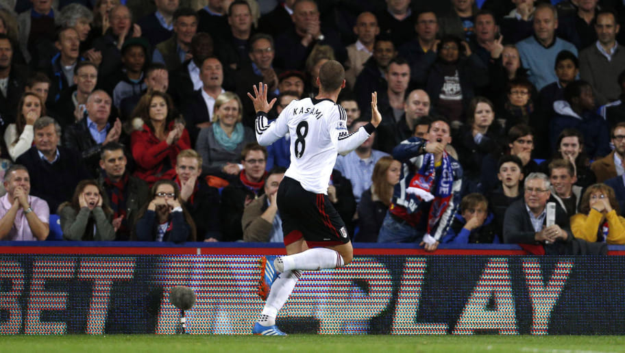 Fulham's Swiss midfielder Pajtim Kasami celebrates scoring his team's first goal during the English Premier League football match between Crystal Palace and Fulham at the Selhurst Park, South London, on October 21, 2013. AFP PHOTO/ ADRIAN DENNIS  RESTRICTED TO EDITORIAL USE. No use with unauthorized audio, video, data, fixture lists, club/league logos or 'live' services. Online in-match use limited to 45 images, no video emulation. No use in betting, games or single club/league/player publications        (Photo credit should read ADRIAN DENNIS/AFP/Getty Images)
