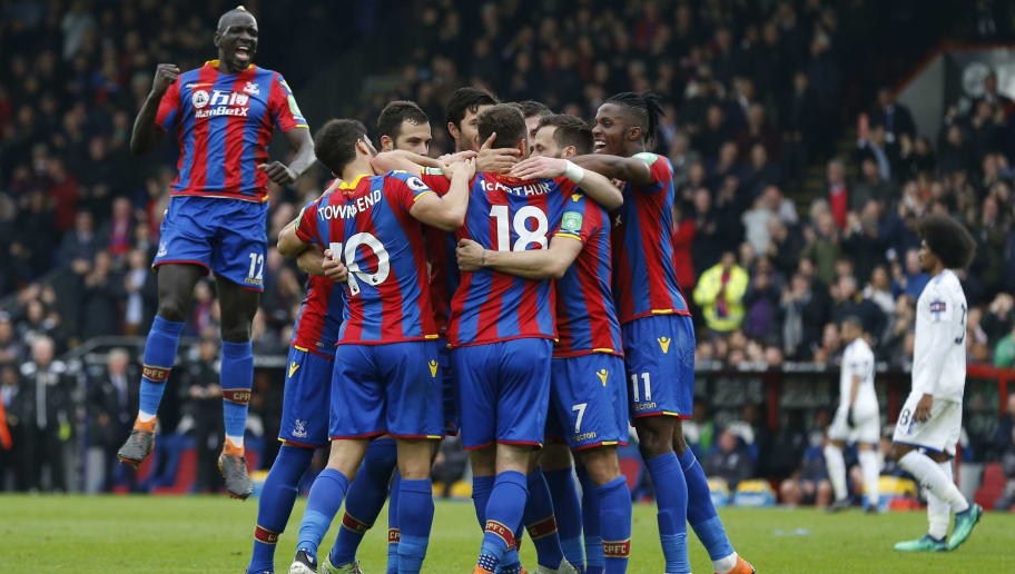 Crystal Palace's Scottish midfielder James McArthur celebrates with teammates aftere scoring the team's second goal during the English Premier League football match between Crystal Palace and Leicester City at Selhurst Park in south London on April 28, 2018. (Photo by Ian KINGTON / AFP) / RESTRICTED TO EDITORIAL USE. No use with unauthorized audio, video, data, fixture lists, club/league logos or 'live' services. Online in-match use limited to 75 images, no video emulation. No use in betting, games or single club/league/player publications. /         (Photo credit should read IAN KINGTON/AFP/Getty Images)