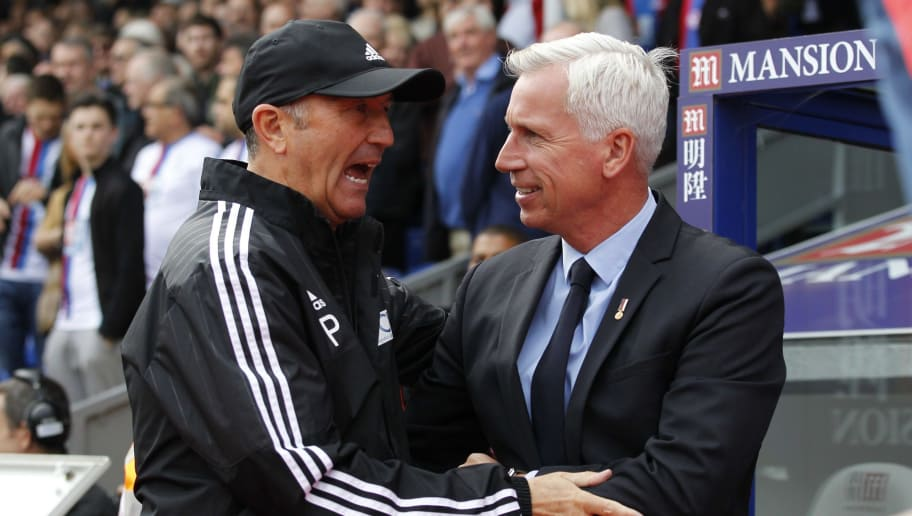 Crystal Palaces English manager Alan Pardew (R) greets West Bromwich Albions Welsh manager Tony Pulis ahead of the English Premier League football match between Crystal Palace and West Bromwich Albion at Selhurst Park in south London on October 3, 2015. AFP PHOTO / IAN KINGTON  RESTRICTED TO EDITORIAL USE. No use with unauthorized audio, video, data, fixture lists, club/league logos or 'live' services. Online in-match use limited to 75 images, no video emulation. No use in betting, games or single club/league/player publications.        (Photo credit should read IAN KINGTON/AFP/Getty Images)