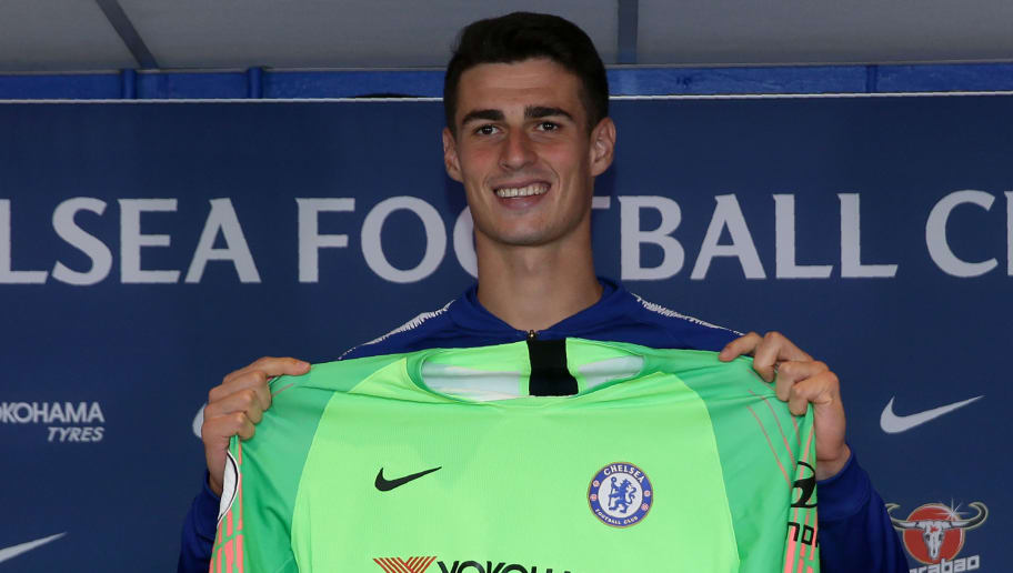 Chelsea's new goalkeeper, Spain's Kepa Arrizabalaga holds up a team football shirt as he attend his unveiling press conference at Stamford Bridge in west London on August 9, 2018. - Spain's Kepa Arrizabalaga became the most expensive goalkeeper in history after Chelsea confirmed his 80 million euro (£71.6 million, $92 million) move from Athletic Bilbao. (Photo by Daniel LEAL-OLIVAS / AFP)        (Photo credit should read DANIEL LEAL-OLIVAS/AFP/Getty Images)