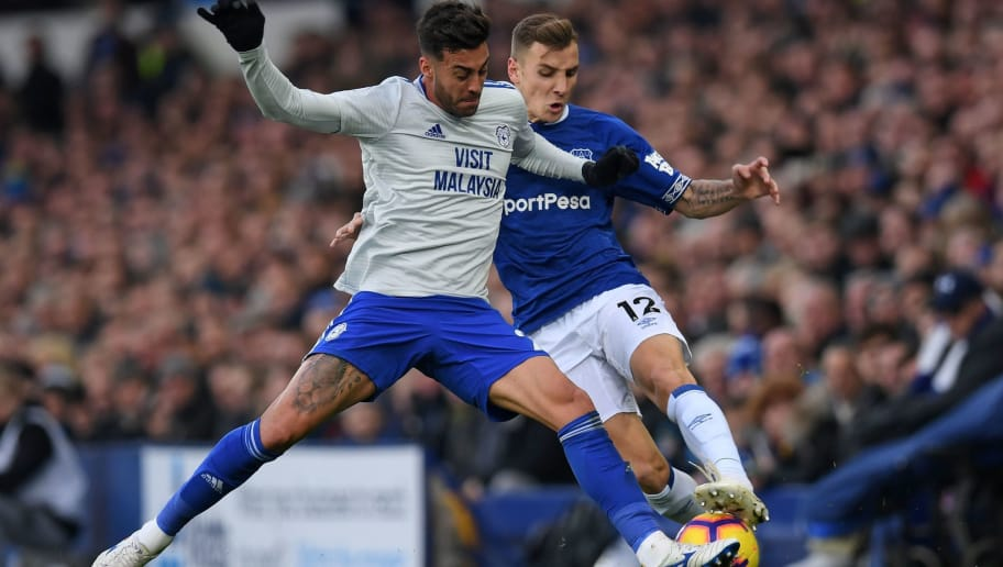 Cardiff City's Spanish midfielder Víctor Camarasa (L) vies with Everton's French defender Lucas Digne (R) during the English Premier League football match between Everton and Cardiff City at Goodison Park in Liverpool, north west England on November 24, 2018. (Photo by Paul ELLIS / AFP) / RESTRICTED TO EDITORIAL USE. No use with unauthorized audio, video, data, fixture lists, club/league logos or 'live' services. Online in-match use limited to 120 images. An additional 40 images may be used in extra time. No video emulation. Social media in-match use limited to 120 images. An additional 40 images may be used in extra time. No use in betting publications, games or single club/league/player publications. /         (Photo credit should read PAUL ELLIS/AFP/Getty Images)