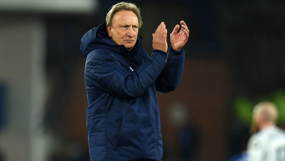 Cardiff City's English manager Neil Warnock applauds supporters on the pitch after the English Premier League football match between Everton and Cardiff City at Goodison Park in Liverpool, north west England on November 24, 2018. - Everton won the game 1-0. (Photo by Paul ELLIS / AFP) / RESTRICTED TO EDITORIAL USE. No use with unauthorized audio, video, data, fixture lists, club/league logos or 'live' services. Online in-match use limited to 120 images. An additional 40 images may be used in extra time. No video emulation. Social media in-match use limited to 120 images. An additional 40 images may be used in extra time. No use in betting publications, games or single club/league/player publications. /         (Photo credit should read PAUL ELLIS/AFP/Getty Images)