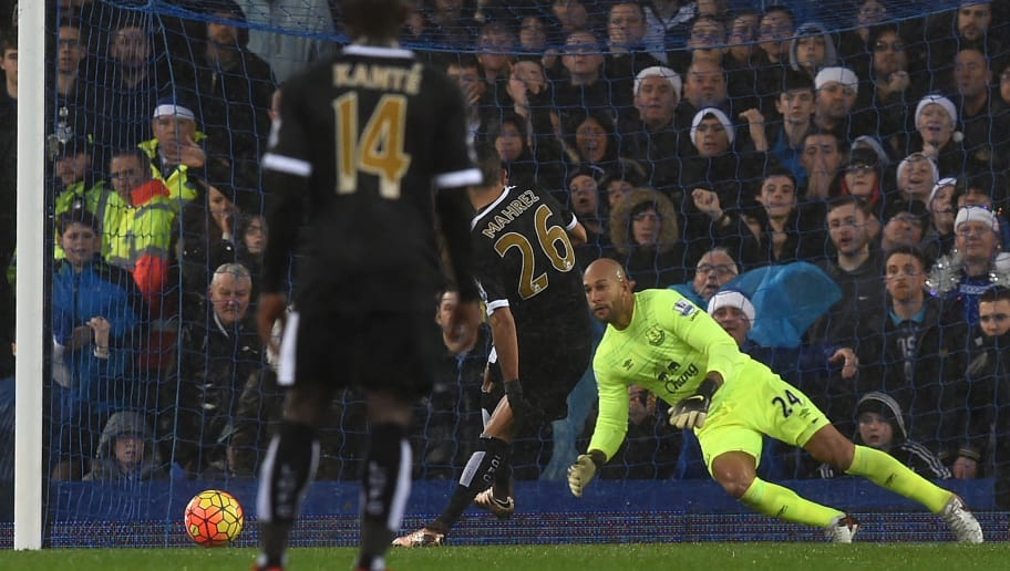 Leicester City's Algerian midfielder Riyad Mahrez (2nd R) scores a penalty past Everton's US goalkeeper Tim Howard to open the scoring in the English Premier League football match between Everton and Leicester City at Goodison Park in Liverpool, north west England on December 19, 2015. AFP PHOTO / PAUL ELLIS  RESTRICTED TO EDITORIAL USE. NO USE WITH UNAUTHORIZED AUDIO, VIDEO, DATA, FIXTURE LISTS, CLUB/LEAGUE LOGOS OR 'LIVE' SERVICES. ONLINE IN-MATCH USE LIMITED TO 75 IMAGES, NO VIDEO EMULATION. NO USE IN BETTING, GAMES OR SINGLE CLUB/LEAGUE/PLAYER PUBLICATIONS. / AFP / PAUL ELLIS        (Photo credit should read PAUL ELLIS/AFP/Getty Images)