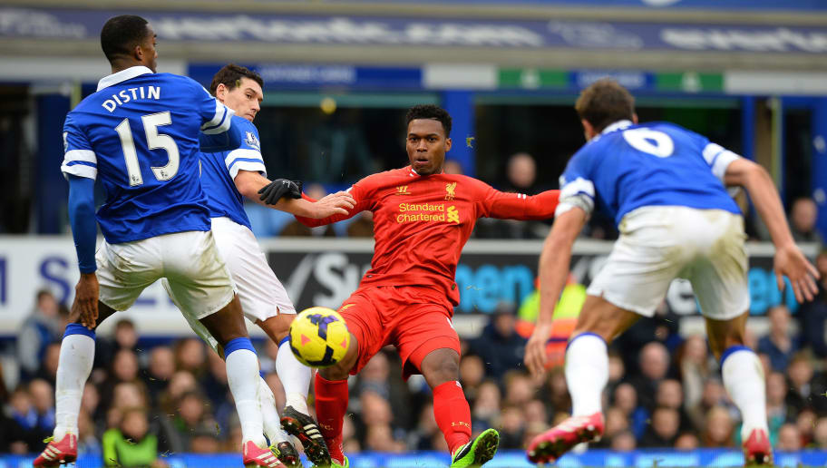 Liverpool's English striker Daniel Sturridge (2R) is tackled by Everton's French defender Sylvain Distin (L) and Everton's English midfielder Gareth Barry (2L) during the English Premier League football match between Everton and Liverpool at Goodison park in Liverpool on November 23, 2013. The game ended in a 3-3 draw.  AFP PHOTO/PAUL ELLIS - RESTRICTED TO EDITORIAL USE. NO USE WITH UNAUTHORIZED AUDIO, VIDEO, DATA, FIXTURE LISTS, CLUB/LEAGUE LOGOS OR LIVE SERVICES. ONLINE IN-MATCH USE LIMITED TO 45 IMAGES, NO VIDEO EMULATION. NO USE IN BETTING, GAMES OR SINGLE CLUB/LEAGUE/PLAYER PUBLICATIONS.        (Photo credit should read PAUL ELLIS/AFP/Getty Images)