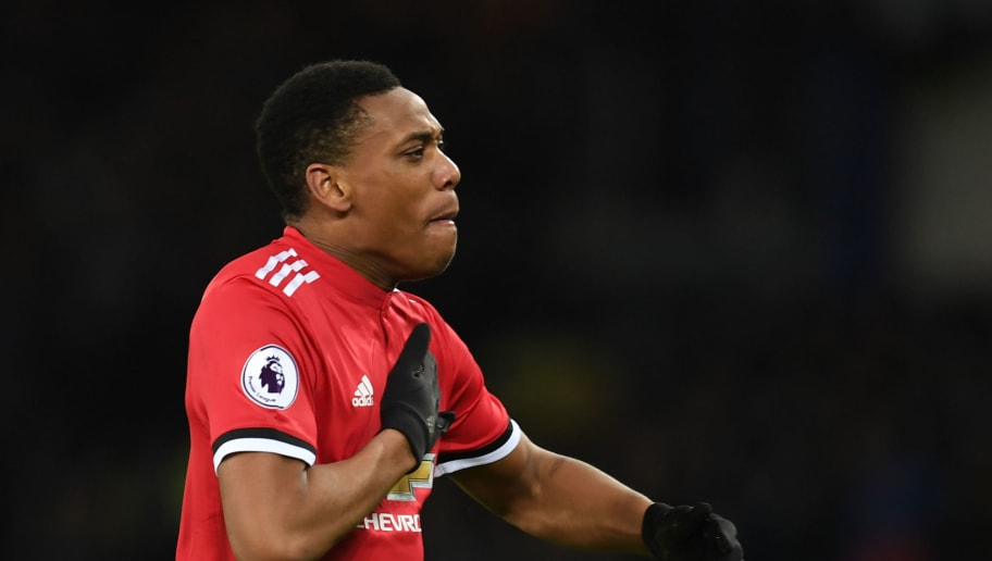 Manchester United's French striker Anthony Martial celebrates scoring the team's first goal during the English Premier League football match between Everton and Manchester United at Goodison Park in Liverpool, north west England on January 1, 2018. / AFP PHOTO / Paul ELLIS / RESTRICTED TO EDITORIAL USE. No use with unauthorized audio, video, data, fixture lists, club/league logos or 'live' services. Online in-match use limited to 75 images, no video emulation. No use in betting, games or single club/league/player publications.  /         (Photo credit should read PAUL ELLIS/AFP/Getty Images)