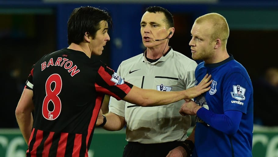 Queens Park Rangers' English midfielder Joey Barton (L) has words with Everton's Scottish striker Steven Naismith (R) with referee Neil Swarbrick (C) during the English Premier League football match between Everton and Queens Park Rangers at Goodison Park in Liverpool, north-west England, on December 15, 2014. AFP PHOTO / PAUL ELLIS  RESTRICTED TO EDITORIAL USE. No use with unauthorized audio, video, data, fixture lists, club/league logos or live services. Online in-match use limited to 45 images, no video emulation. No use in betting, games or single club/league/player publications        (Photo credit should read PAUL ELLIS/AFP/Getty Images)