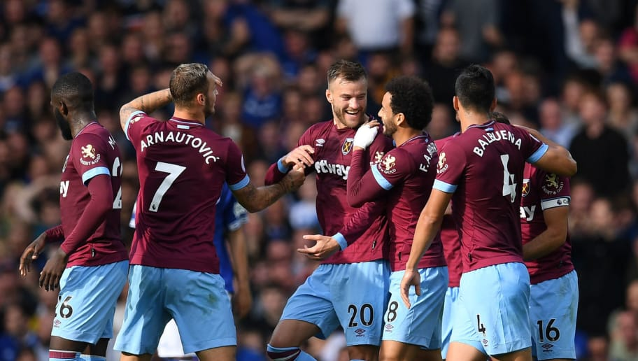 West Ham United's Ukrainian striker Andriy Yarmolenko (C) celebrates with teammates after scoring their second goal during the English Premier League football match between Everton and West Ham United at Goodison Park in Liverpool, north west England on September 16, 2018. (Photo by Paul ELLIS / AFP) / RESTRICTED TO EDITORIAL USE. No use with unauthorized audio, video, data, fixture lists, club/league logos or 'live' services. Online in-match use limited to 120 images. An additional 40 images may be used in extra time. No video emulation. Social media in-match use limited to 120 images. An additional 40 images may be used in extra time. No use in betting publications, games or single club/league/player publications. /         (Photo credit should read PAUL ELLIS/AFP/Getty Images)