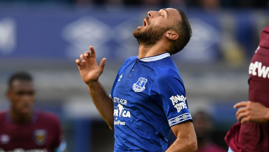 Everton's Turkish striker Cenk Tosun reacts during the English Premier League football match between Everton and West Ham United at Goodison Park in Liverpool, north west England on September 16, 2018. (Photo by Paul ELLIS / AFP) / RESTRICTED TO EDITORIAL USE. No use with unauthorized audio, video, data, fixture lists, club/league logos or 'live' services. Online in-match use limited to 120 images. An additional 40 images may be used in extra time. No video emulation. Social media in-match use limited to 120 images. An additional 40 images may be used in extra time. No use in betting publications, games or single club/league/player publications. /         (Photo credit should read PAUL ELLIS/AFP/Getty Images)