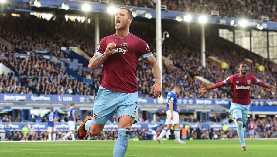 West Ham United's Austrian midfielder Marko Arnautovic celebrates after scoring their third goal during the English Premier League football match between Everton and West Ham United at Goodison Park in Liverpool, north west England on September 16, 2018. (Photo by Paul ELLIS / AFP) / RESTRICTED TO EDITORIAL USE. No use with unauthorized audio, video, data, fixture lists, club/league logos or 'live' services. Online in-match use limited to 120 images. An additional 40 images may be used in extra time. No video emulation. Social media in-match use limited to 120 images. An additional 40 images may be used in extra time. No use in betting publications, games or single club/league/player publications. /         (Photo credit should read PAUL ELLIS/AFP/Getty Images)