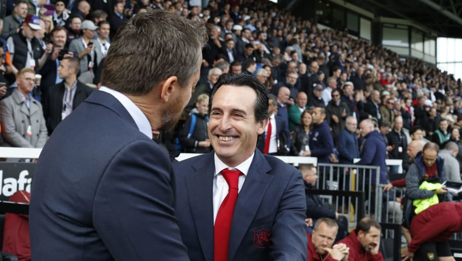 Fulham's Serbian manager Slavisa Jokanovic (L) greets Arsenal's Spanish head coach Unai Emery before the English Premier League football match between Fulham and Arsenal at Craven Cottage in London on October 7, 2018. (Photo by Adrian DENNIS / AFP) / RESTRICTED TO EDITORIAL USE. No use with unauthorized audio, video, data, fixture lists, club/league logos or 'live' services. Online in-match use limited to 120 images. An additional 40 images may be used in extra time. No video emulation. Social media in-match use limited to 120 images. An additional 40 images may be used in extra time. No use in betting publications, games or single club/league/player publications. /         (Photo credit should read ADRIAN DENNIS/AFP/Getty Images)