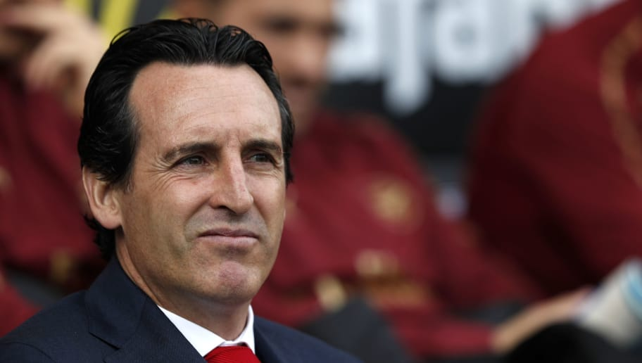 Arsenal's Spanish head coach Unai Emery looks on before the English Premier League football match between Fulham and Arsenal at Craven Cottage in London on October 7, 2018. (Photo by Adrian DENNIS / AFP) / RESTRICTED TO EDITORIAL USE. No use with unauthorized audio, video, data, fixture lists, club/league logos or 'live' services. Online in-match use limited to 120 images. An additional 40 images may be used in extra time. No video emulation. Social media in-match use limited to 120 images. An additional 40 images may be used in extra time. No use in betting publications, games or single club/league/player publications. /         (Photo credit should read ADRIAN DENNIS/AFP/Getty Images)