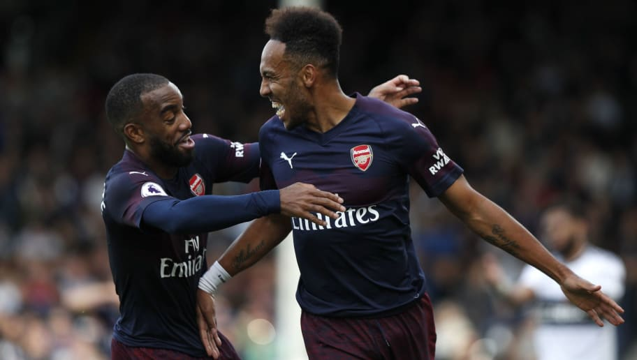 Arsenal's Gabonese striker Pierre-Emerick Aubameyang (R) celebrates with Arsenal's French striker Alexandre Lacazette (L) after scoring the team's fourth goal during the English Premier League football match between Fulham and Arsenal at Craven Cottage in London on October 7, 2018. (Photo by Adrian DENNIS / AFP) / RESTRICTED TO EDITORIAL USE. No use with unauthorized audio, video, data, fixture lists, club/league logos or 'live' services. Online in-match use limited to 120 images. An additional 40 images may be used in extra time. No video emulation. Social media in-match use limited to 120 images. An additional 40 images may be used in extra time. No use in betting publications, games or single club/league/player publications. / The erroneous mention[s] appearing in the metadata of this photo by Adrian DENNIS has been modified in AFP systems in the following manner: [Arsenal's French striker Alexandre Lacazette] instead of [Arsenal's English striker Danny Welbeck]. Please immediately remove the erroneous mention[s] from all your online services and delete it (them) from your servers. If you have been authorized by AFP to distribute it (them) to third parties, please ensure that the same actions are carried out by them. Failure to promptly comply with these instructions will entail liability on your part for any continued or post notification usage. Therefore we thank you very much for all your attention and prompt action. We are sorry for the inconvenience this notification may cause and remain at your disposal for any further information you may require.        (Photo credit should read ADRIAN DENNIS/AFP/Getty Images)