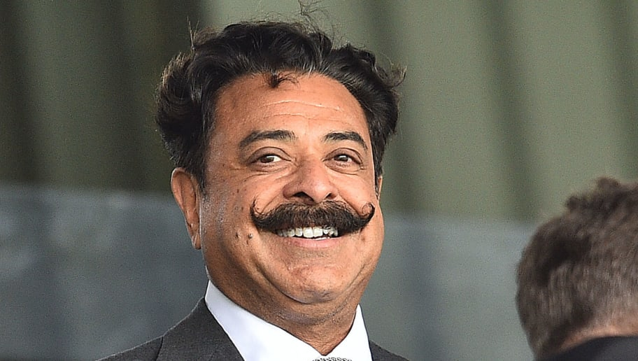 Fulham's US owner Shahid Khan reacts ahead of the English Premier League football match between Fulham and Crystal Palace at Craven Cottage in London on August 11, 2018. (Photo by Glyn KIRK / AFP) / RESTRICTED TO EDITORIAL USE. No use with unauthorized audio, video, data, fixture lists, club/league logos or 'live' services. Online in-match use limited to 75 images, no video emulation. No use in betting, games or single club/league/player publications. /         (Photo credit should read GLYN KIRK/AFP/Getty Images)