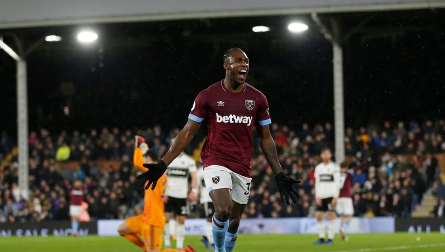 West Ham United's English midfielder Michail Antonio celebrates scoring his team's second goal during the English Premier League football match between Fulham and West Ham United at Craven Cottage in London on December 15, 2018. (Photo by Ian KINGTON / AFP) / RESTRICTED TO EDITORIAL USE. No use with unauthorized audio, video, data, fixture lists, club/league logos or 'live' services. Online in-match use limited to 120 images. An additional 40 images may be used in extra time. No video emulation. Social media in-match use limited to 120 images. An additional 40 images may be used in extra time. No use in betting publications, games or single club/league/player publications. /         (Photo credit should read IAN KINGTON/AFP/Getty Images)