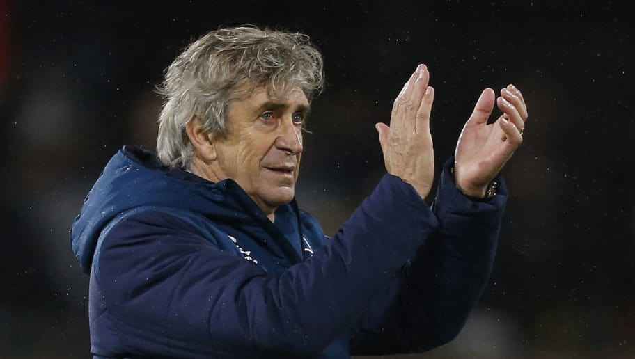 West Ham United's Chilean manager Manuel Pellegrini applauds the fans following the English Premier League football match between Fulham and West Ham United at Craven Cottage in London on December 15, 2018. (Photo by Ian KINGTON / AFP) / RESTRICTED TO EDITORIAL USE. No use with unauthorized audio, video, data, fixture lists, club/league logos or 'live' services. Online in-match use limited to 120 images. An additional 40 images may be used in extra time. No video emulation. Social media in-match use limited to 120 images. An additional 40 images may be used in extra time. No use in betting publications, games or single club/league/player publications. /         (Photo credit should read IAN KINGTON/AFP/Getty Images)