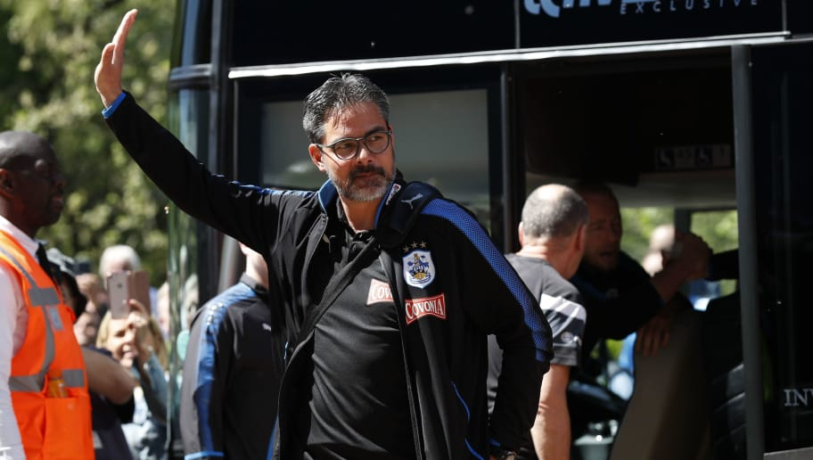 Huddersfield Town's German head coach David Wagner waves as he arrives for the English Premier League football match between Huddersfield Town and Arsenal at the John Smith's stadium in Huddersfield, northern England on May 13, 2018. (Photo by Adrian DENNIS / AFP) / RESTRICTED TO EDITORIAL USE. No use with unauthorized audio, video, data, fixture lists, club/league logos or 'live' services. Online in-match use limited to 75 images, no video emulation. No use in betting, games or single club/league/player publications. /         (Photo credit should read ADRIAN DENNIS/AFP/Getty Images)