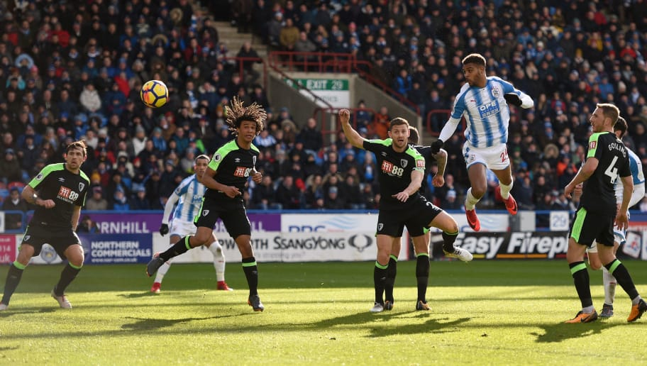 Huddersfield Town's Beninese striker Steve Mounie (2R) scores the team's second goal during the English Premier League football match between Huddersfield Town and Bournemouth at the John Smith's stadium in Huddersfield, northern England on February 11, 2018. / AFP PHOTO / Oli SCARFF / RESTRICTED TO EDITORIAL USE. No use with unauthorized audio, video, data, fixture lists, club/league logos or 'live' services. Online in-match use limited to 75 images, no video emulation. No use in betting, games or single club/league/player publications.  /         (Photo credit should read OLI SCARFF/AFP/Getty Images)