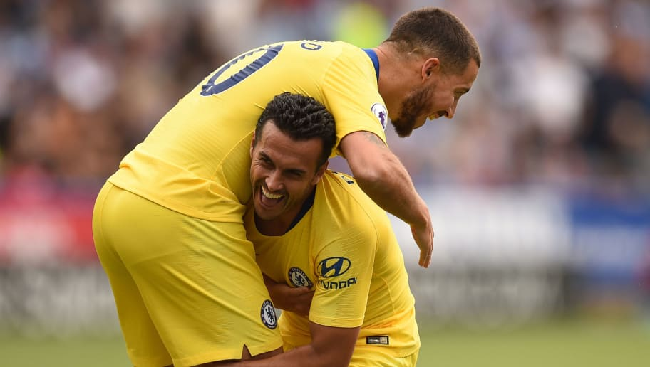 Chelsea's Spanish midfielder Pedro (R) celebrates with Chelsea's Belgian midfielder Eden Hazard after scoring the team's third goal past Huddersfield Town's English goalkeeper Ben Hamer during the English Premier League football match between Huddersfield Town and Chelsea at the John Smith's stadium in Huddersfield, northern England on August 11, 2018. (Photo by Oli SCARFF / AFP) / RESTRICTED TO EDITORIAL USE.No use with unauthorized audio, video, data, fixture lists, club/league logos or 'live' services. Online in-match use limited to 120 images. An additional 40 images may be used in extra time. No video emulation. Social media in-match use limited to 120 images. An additional 40 images may be used in extra time. No use in betting publications, games or single club/league/player publications/ /         (Photo credit should read OLI SCARFF/AFP/Getty Images)