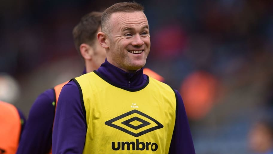 Everton's English striker Wayne Rooney smiles as he warm up ahead of the English Premier League football match between Huddersfield Town and Everton at the John Smith's stadium in Huddersfield, northern England on April 28, 2018. (Photo by Oli SCARFF / AFP) / RESTRICTED TO EDITORIAL USE. No use with unauthorized audio, video, data, fixture lists, club/league logos or 'live' services. Online in-match use limited to 75 images, no video emulation. No use in betting, games or single club/league/player publications. /         (Photo credit should read OLI SCARFF/AFP/Getty Images)