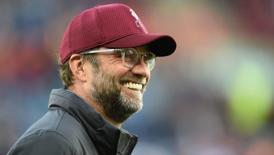 Liverpool's German manager Jurgen Klopp smiles as he checks out the conditions ahead of the English Premier League football match between Huddersfield Town and Liverpool at the John Smith's stadium in Huddersfield, northern England on October 20, 2018. (Photo by Oli SCARFF / AFP) / RESTRICTED TO EDITORIAL USE. No use with unauthorized audio, video, data, fixture lists, club/league logos or 'live' services. Online in-match use limited to 120 images. An additional 40 images may be used in extra time. No video emulation. Social media in-match use limited to 120 images. An additional 40 images may be used in extra time. No use in betting publications, games or single club/league/player publications. /         (Photo credit should read OLI SCARFF/AFP/Getty Images)