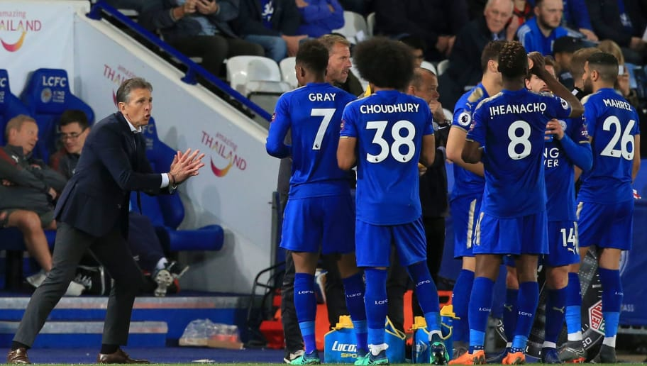 Leicester City's French manager Claude Puel (L) talks with his players during a break in play during the English Premier League football match between Leicester City and Arsenal at King Power Stadium in Leicester, central England on May 9, 2018. (Photo by Lindsey PARNABY / AFP) / RESTRICTED TO EDITORIAL USE. No use with unauthorized audio, video, data, fixture lists, club/league logos or 'live' services. Online in-match use limited to 75 images, no video emulation. No use in betting, games or single club/league/player publications. /         (Photo credit should read LINDSEY PARNABY/AFP/Getty Images)