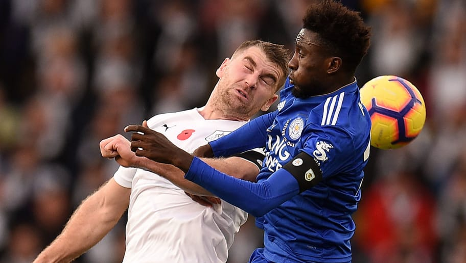 Burnley's Welsh striker Sam Vokes (L) vies with Leicester City's Nigerian midfielder Wilfred Ndidi during the English Premier League football match between Leicester City and Burnley at King Power Stadium in Leicester, central England on November 10, 2018. (Photo by Oli SCARFF / AFP) / RESTRICTED TO EDITORIAL USE. No use with unauthorized audio, video, data, fixture lists, club/league logos or 'live' services. Online in-match use limited to 120 images. An additional 40 images may be used in extra time. No video emulation. Social media in-match use limited to 120 images. An additional 40 images may be used in extra time. No use in betting publications, games or single club/league/player publications. /         (Photo credit should read OLI SCARFF/AFP/Getty Images)