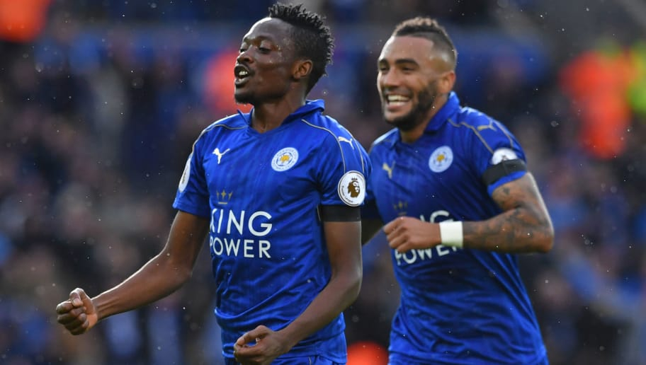 Leicester City's Nigerian midfielder Ahmed Musa (L) celebrates with Leicester City's English defender Danny Simpson after scoring the opening goal of the English Premier League football match between Leicester City and Crystal Palace at King Power Stadium in Leicester, central England on October 22, 2016. / AFP / Ben STANSALL / RESTRICTED TO EDITORIAL USE. No use with unauthorized audio, video, data, fixture lists, club/league logos or 'live' services. Online in-match use limited to 75 images, no video emulation. No use in betting, games or single club/league/player publications.  /         (Photo credit should read BEN STANSALL/AFP/Getty Images)