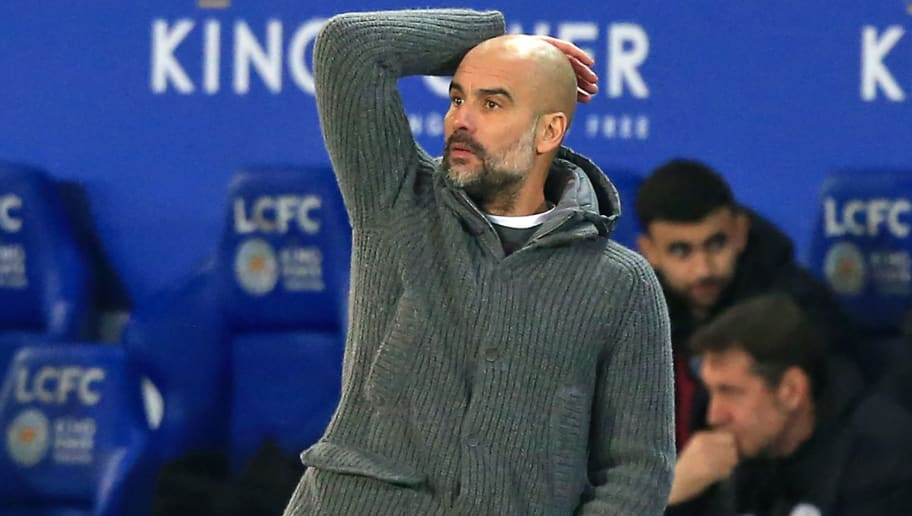 Manchester City's Spanish manager Pep Guardiola gestures on the touchline during the English Premier League football match between Leicester City and Manchester City at King Power Stadium in Leicester, central England on December 26, 2018. (Photo by Lindsey PARNABY / AFP) / RESTRICTED TO EDITORIAL USE. No use with unauthorized audio, video, data, fixture lists, club/league logos or 'live' services. Online in-match use limited to 120 images. An additional 40 images may be used in extra time. No video emulation. Social media in-match use limited to 120 images. An additional 40 images may be used in extra time. No use in betting publications, games or single club/league/player publications. /         (Photo credit should read LINDSEY PARNABY/AFP/Getty Images)