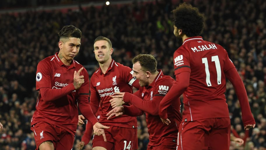 Liverpool's Brazilian midfielder Roberto Firmino (L) celebrates shooting from the penalty spot to score his team's fifth goal during the English Premier League football match between Liverpool and Arsenal at Anfield in Liverpool, north west England on December 29, 2018. (Photo by Paul ELLIS / AFP) / RESTRICTED TO EDITORIAL USE. No use with unauthorized audio, video, data, fixture lists, club/league logos or 'live' services. Online in-match use limited to 120 images. An additional 40 images may be used in extra time. No video emulation. Social media in-match use limited to 120 images. An additional 40 images may be used in extra time. No use in betting publications, games or single club/league/player publications. /         (Photo credit should read PAUL ELLIS/AFP/Getty Images)