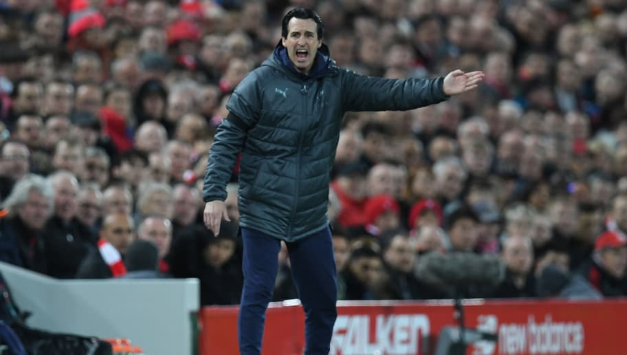 Arsenal's Spanish head coach Unai Emery shouts instructions to his players from the touchline during the English Premier League football match between Liverpool and Arsenal at Anfield in Liverpool, north west England on December 29, 2018. (Photo by Paul ELLIS / AFP) / RESTRICTED TO EDITORIAL USE. No use with unauthorized audio, video, data, fixture lists, club/league logos or 'live' services. Online in-match use limited to 120 images. An additional 40 images may be used in extra time. No video emulation. Social media in-match use limited to 120 images. An additional 40 images may be used in extra time. No use in betting publications, games or single club/league/player publications. /         (Photo credit should read PAUL ELLIS/AFP/Getty Images)