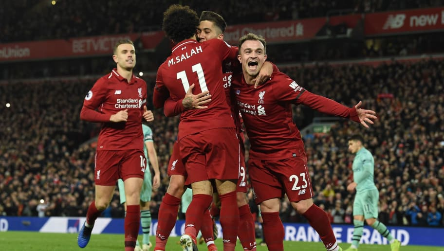 Liverpool's Brazilian midfielder Roberto Firmino (2R) celebrates shooting from the penalty spot to score his team's fifth goal during the English Premier League football match between Liverpool and Arsenal at Anfield in Liverpool, north west England on December 29, 2018. (Photo by Paul ELLIS / AFP) / RESTRICTED TO EDITORIAL USE. No use with unauthorized audio, video, data, fixture lists, club/league logos or 'live' services. Online in-match use limited to 120 images. An additional 40 images may be used in extra time. No video emulation. Social media in-match use limited to 120 images. An additional 40 images may be used in extra time. No use in betting publications, games or single club/league/player publications. /         (Photo credit should read PAUL ELLIS/AFP/Getty Images)