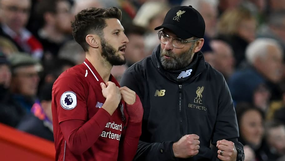 Liverpool's German manager Jurgen Klopp (R) talks with Liverpool's English midfielder Adam Lallana as he waits to be substituted on during the English Premier League football match between Liverpool and Arsenal at Anfield in Liverpool, north west England on December 29, 2018. (Photo by Paul ELLIS / AFP) / RESTRICTED TO EDITORIAL USE. No use with unauthorized audio, video, data, fixture lists, club/league logos or 'live' services. Online in-match use limited to 120 images. An additional 40 images may be used in extra time. No video emulation. Social media in-match use limited to 120 images. An additional 40 images may be used in extra time. No use in betting publications, games or single club/league/player publications. /         (Photo credit should read PAUL ELLIS/AFP/Getty Images)