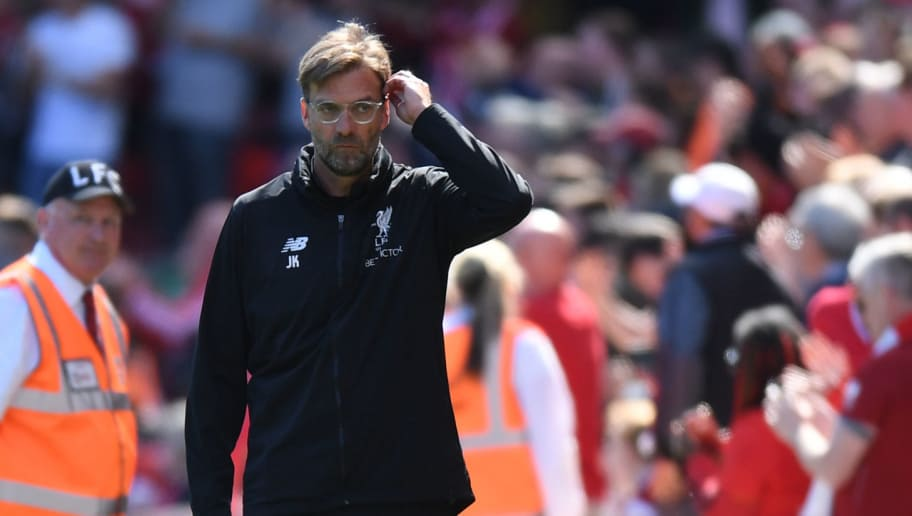Liverpool's German manager Jurgen Klopp looks on during the English Premier League football match between Liverpool and Brighton and Hove Albion at Anfield in Liverpool, north west England on May 13, 2018. (Photo by Paul ELLIS / AFP) / RESTRICTED TO EDITORIAL USE. No use with unauthorized audio, video, data, fixture lists, club/league logos or 'live' services. Online in-match use limited to 75 images, no video emulation. No use in betting, games or single club/league/player publications. /         (Photo credit should read PAUL ELLIS/AFP/Getty Images)