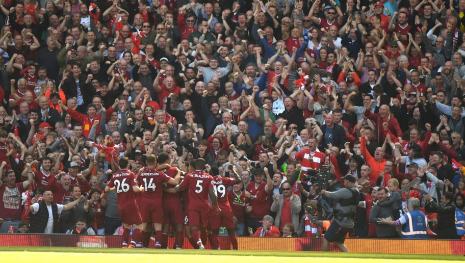 Liverpool's Egyptian midfielder Mohamed Salah celebrates with teammates after scoring during the English Premier League football match between Liverpool and Brighton and Hove Albion at Anfield in Liverpool, north west England on May 13, 2018. (Photo by Paul ELLIS / AFP) / RESTRICTED TO EDITORIAL USE. No use with unauthorized audio, video, data, fixture lists, club/league logos or 'live' services. Online in-match use limited to 75 images, no video emulation. No use in betting, games or single club/league/player publications. /         (Photo credit should read PAUL ELLIS/AFP/Getty Images)