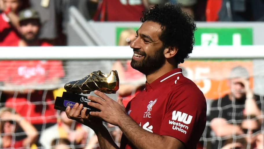 Liverpool's Egyptian midfielder Mohamed Salah celebrates after being awarded the golden boot award for most goals scored in the season after the English Premier League football match between Liverpool and Brighton and Hove Albion at Anfield in Liverpool, north west England on May 13, 2018. (Photo by Paul ELLIS / AFP) / RESTRICTED TO EDITORIAL USE. No use with unauthorized audio, video, data, fixture lists, club/league logos or 'live' services. Online in-match use limited to 75 images, no video emulation. No use in betting, games or single club/league/player publications. /         (Photo credit should read PAUL ELLIS/AFP/Getty Images)