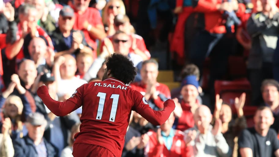 Liverpool's Egyptian midfielder Mohamed Salah celebrates scoring the opening goal during the English Premier League football match between Liverpool and Brighton and Hove Albion at Anfield in Liverpool, north west England on August 25, 2018. (Photo by Lindsey PARNABY / AFP) / RESTRICTED TO EDITORIAL USE. No use with unauthorized audio, video, data, fixture lists, club/league logos or 'live' services. Online in-match use limited to 120 images. An additional 40 images may be used in extra time. No video emulation. Social media in-match use limited to 120 images. An additional 40 images may be used in extra time. No use in betting publications, games or single club/league/player publications. /         (Photo credit should read LINDSEY PARNABY/AFP/Getty Images)