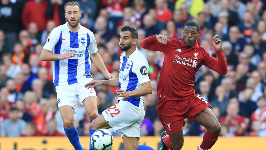 Liverpool's Dutch midfielder Georginio Wijnaldum (R) challenges Brighton's Spanish defender Martin Montoya (C) and Brighton's English striker Glenn Murray (L) during the English Premier League football match between Liverpool and Brighton and Hove Albion at Anfield in Liverpool, north west England on August 25, 2018. (Photo by Lindsey PARNABY / AFP) / RESTRICTED TO EDITORIAL USE. No use with unauthorized audio, video, data, fixture lists, club/league logos or 'live' services. Online in-match use limited to 120 images. An additional 40 images may be used in extra time. No video emulation. Social media in-match use limited to 120 images. An additional 40 images may be used in extra time. No use in betting publications, games or single club/league/player publications. /         (Photo credit should read LINDSEY PARNABY/AFP/Getty Images)