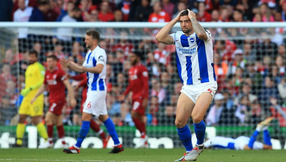 Brighton's Irish defender Shane Duffy (R) reacts to Brighton's French midfielder Anthony Knockaert misses a chance at goal during the English Premier League football match between Liverpool and Brighton and Hove Albion at Anfield in Liverpool, north west England on August 25, 2018. (Photo by Lindsey PARNABY / AFP) / RESTRICTED TO EDITORIAL USE. No use with unauthorized audio, video, data, fixture lists, club/league logos or 'live' services. Online in-match use limited to 120 images. An additional 40 images may be used in extra time. No video emulation. Social media in-match use limited to 120 images. An additional 40 images may be used in extra time. No use in betting publications, games or single club/league/player publications. /         (Photo credit should read LINDSEY PARNABY/AFP/Getty Images)