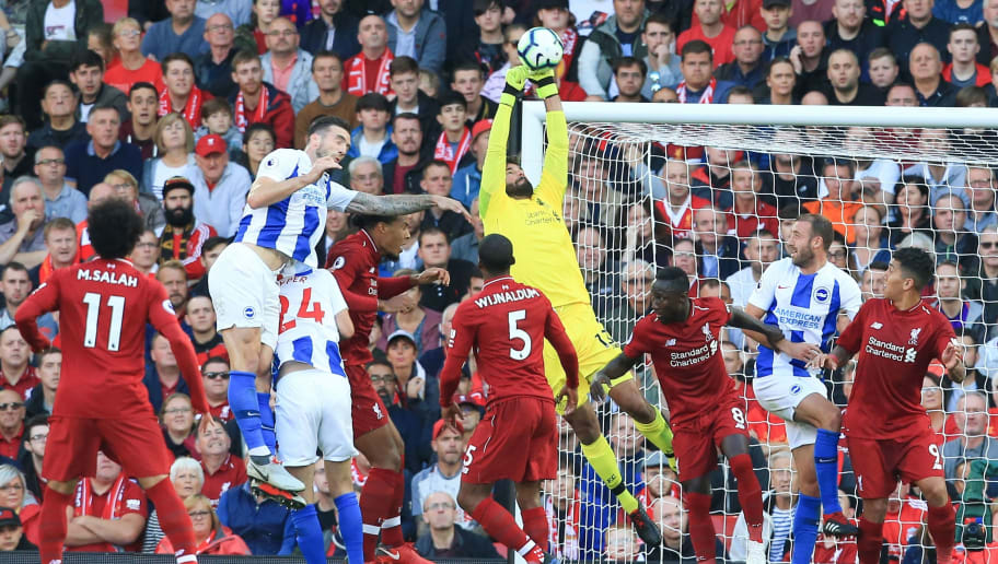 Liverpool's Brazilian goalkeeper Alisson Becker (C) claims the ball during the English Premier League football match between Liverpool and Brighton and Hove Albion at Anfield in Liverpool, north west England on August 25, 2018. (Photo by Lindsey PARNABY / AFP) / RESTRICTED TO EDITORIAL USE. No use with unauthorized audio, video, data, fixture lists, club/league logos or 'live' services. Online in-match use limited to 120 images. An additional 40 images may be used in extra time. No video emulation. Social media in-match use limited to 120 images. An additional 40 images may be used in extra time. No use in betting publications, games or single club/league/player publications. /         (Photo credit should read LINDSEY PARNABY/AFP/Getty Images)