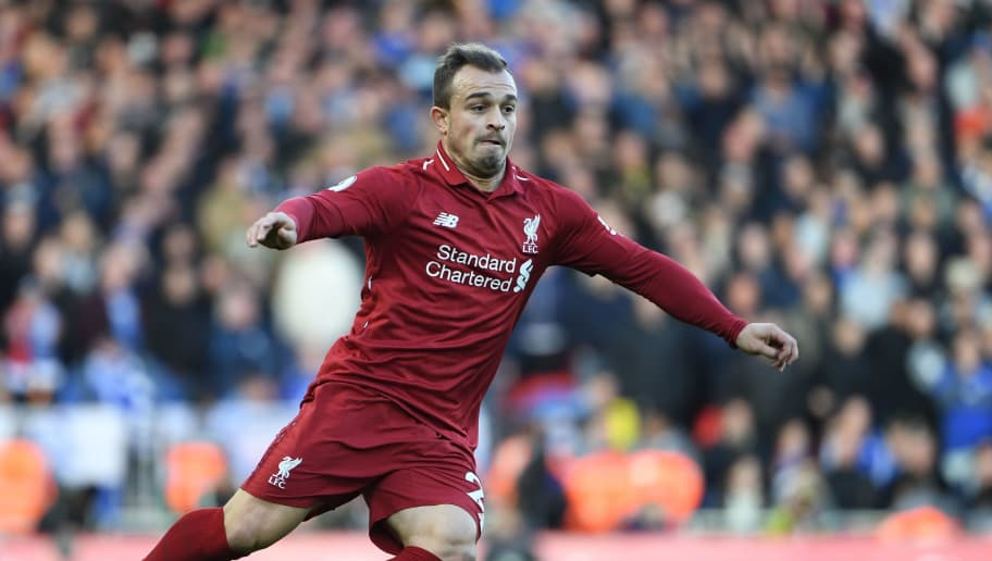 Liverpool's Swiss midfielder Xherdan Shaqiri runs with the ball during the English Premier League football match between Liverpool and Cardiff City at Anfield in Liverpool, north west England on October 27, 2018. (Photo by Paul ELLIS / AFP) / RESTRICTED TO EDITORIAL USE. No use with unauthorized audio, video, data, fixture lists, club/league logos or 'live' services. Online in-match use limited to 120 images. An additional 40 images may be used in extra time. No video emulation. Social media in-match use limited to 120 images. An additional 40 images may be used in extra time. No use in betting publications, games or single club/league/player publications. /         (Photo credit should read PAUL ELLIS/AFP/Getty Images)