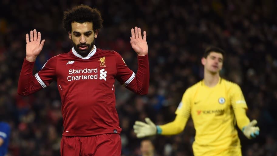 Liverpool's Egyptian midfielder Mohamed Salah (L) reacts after scoring the opening goal of the English Premier League football match between Liverpool and  Chelsea at Anfield in Liverpool, north west England on November 25, 2017. The game finished 1-1. / AFP PHOTO / Paul ELLIS / RESTRICTED TO EDITORIAL USE. No use with unauthorized audio, video, data, fixture lists, club/league logos or 'live' services. Online in-match use limited to 75 images, no video emulation. No use in betting, games or single club/league/player publications.  /         (Photo credit should read PAUL ELLIS/AFP/Getty Images)
