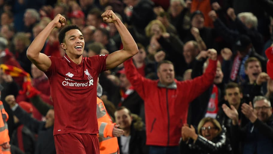 Liverpool's English defender Trent Alexander-Arnold celebrates on the pitch after the English Premier League football match between Liverpool and Everton at Anfield in Liverpool, north west England on December 2, 2018. - Liverpool won the game 1-0. (Photo by Oli SCARFF / AFP) / RESTRICTED TO EDITORIAL USE. No use with unauthorized audio, video, data, fixture lists, club/league logos or 'live' services. Online in-match use limited to 120 images. An additional 40 images may be used in extra time. No video emulation. Social media in-match use limited to 120 images. An additional 40 images may be used in extra time. No use in betting publications, games or single club/league/player publications. /         (Photo credit should read OLI SCARFF/AFP/Getty Images)