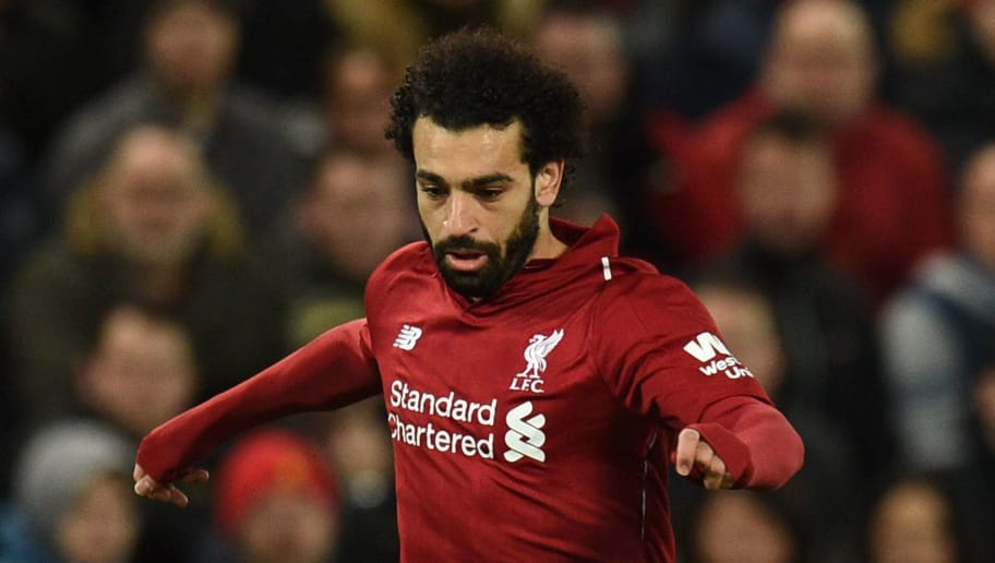 Liverpool's Egyptian midfielder Mohamed Salah runs with the ball during the English Premier League football match between Liverpool and Everton at Anfield in Liverpool, north west England on December 2, 2018. (Photo by Oli SCARFF / AFP) / RESTRICTED TO EDITORIAL USE. No use with unauthorized audio, video, data, fixture lists, club/league logos or 'live' services. Online in-match use limited to 120 images. An additional 40 images may be used in extra time. No video emulation. Social media in-match use limited to 120 images. An additional 40 images may be used in extra time. No use in betting publications, games or single club/league/player publications. /         (Photo credit should read OLI SCARFF/AFP/Getty Images)
