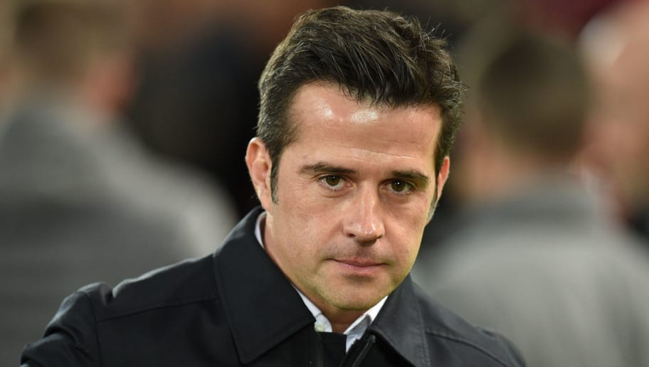 Everton's Portuguese manager Marco Silva is seen before kick off of the English Premier League football match between Liverpool and Everton at Anfield in Liverpool, north west England on December 2, 2018. (Photo by Oli SCARFF / AFP) / RESTRICTED TO EDITORIAL USE. No use with unauthorized audio, video, data, fixture lists, club/league logos or 'live' services. Online in-match use limited to 120 images. An additional 40 images may be used in extra time. No video emulation. Social media in-match use limited to 120 images. An additional 40 images may be used in extra time. No use in betting publications, games or single club/league/player publications. /         (Photo credit should read OLI SCARFF/AFP/Getty Images)